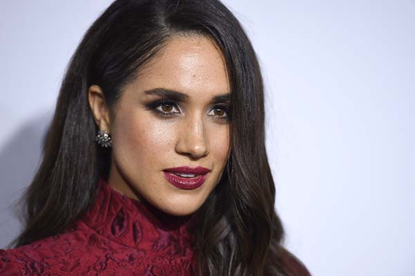 """<div class=""""meta image-caption""""><div class=""""origin-logo origin-image ap""""><span>AP</span></div><span class=""""caption-text"""">Meghan Markle arrives at ELLE's 6th annual Women in Television celebration at the Sunset Tower Hotel (Jordan Strauss/Invision/AP)</span></div>"""