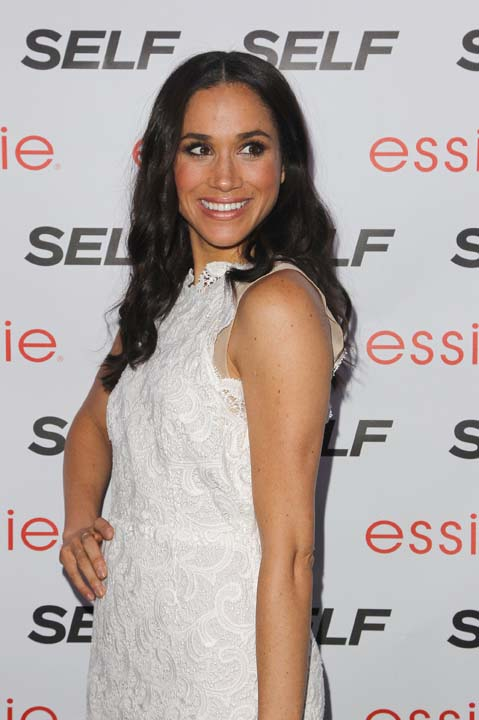 """<div class=""""meta image-caption""""><div class=""""origin-logo origin-image ap""""><span>AP</span></div><span class=""""caption-text"""">Meghan Markle is seen at the Self Rock the Summer, on Tuesday, July, 16, 2013 in New York (Donald Traill/Invision/AP)</span></div>"""