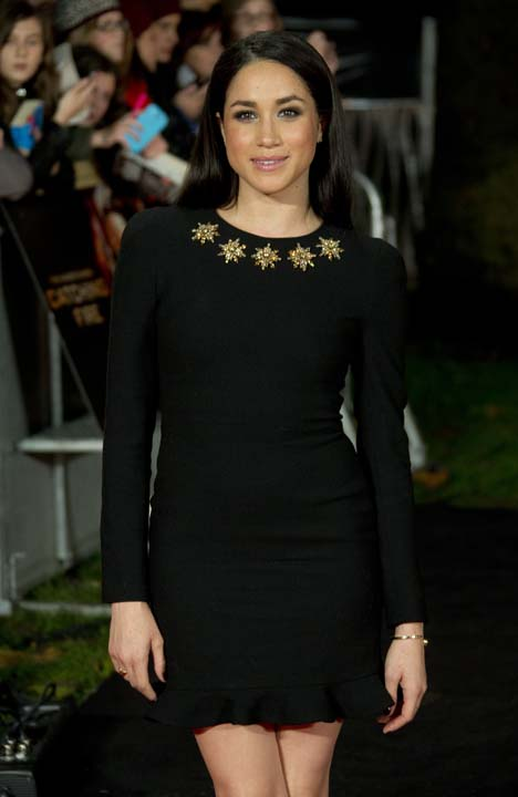 """<div class=""""meta image-caption""""><div class=""""origin-logo origin-image ap""""><span>AP</span></div><span class=""""caption-text"""">Meghan Markle arrives on the red carpet for the World Premiere of Hunger Games: Catching Fire (Joel Ryan/Invision/AP)</span></div>"""
