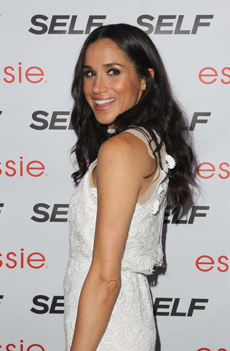 """<div class=""""meta image-caption""""><div class=""""origin-logo origin-image ap""""><span>AP</span></div><span class=""""caption-text"""">Meghan Markle is seen at the Self Rock the Summer, on Tuesday, July, 16, 2013 in New York. (Photo by Donald Traill/Invision/AP) (Donald Traill/Invision/AP)</span></div>"""
