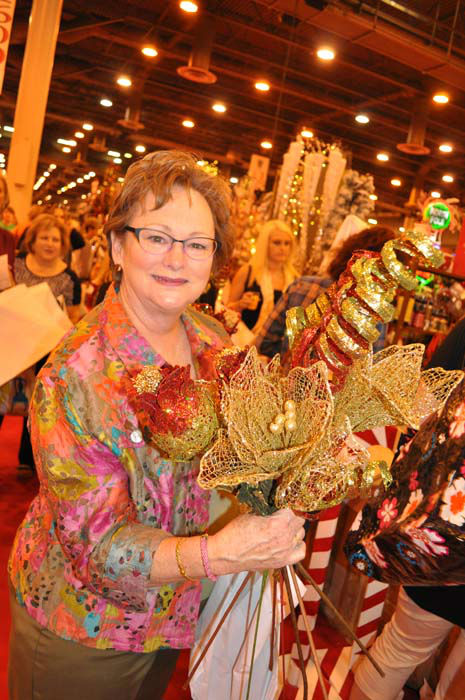 <div class='meta'><div class='origin-logo' data-origin='none'></div><span class='caption-text' data-credit='KTRK Photo/ Amanda Cochran'>A woman shows off her purchases at the Houston Ballet Nutcracker Market</span></div>