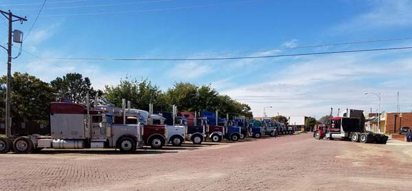 <div class='meta'><div class='origin-logo' data-origin='KTRK'></div><span class='caption-text' data-credit='Family photo'>Trucks lined up outside a church in Ralls, Texas for the funeral of a trucker who died in a car crash.</span></div>