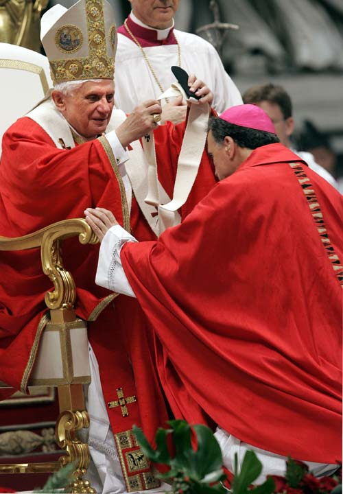 <div class='meta'><div class='origin-logo' data-origin='AP'></div><span class='caption-text' data-credit='AP/Pier Paolo Cito'>Pope Benedict XVI bestowes the pallium, or a woolen shawl, on Daniel N. DiNardo, Archbishop  of Galveston-Houston, TX, during a mass</span></div>