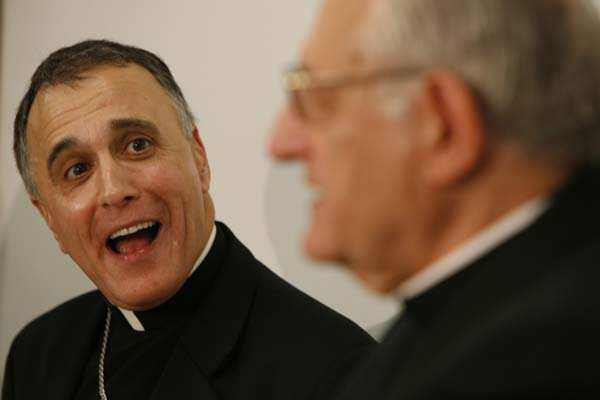 <div class='meta'><div class='origin-logo' data-origin='AP'></div><span class='caption-text' data-credit='AP Photo/Houston Chronicle, Melissa Phillip'>Daniel N. DiNardo, left, laughs at a humorous remarks made by Archbishop Joseph A. Fiorenza</span></div>