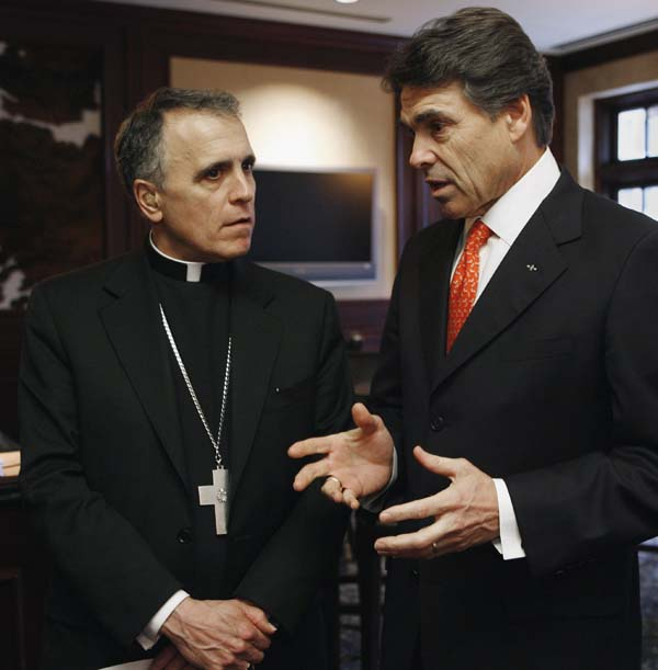 <div class='meta'><div class='origin-logo' data-origin='AP'></div><span class='caption-text' data-credit='AP Photo/Harry Cabluck'>Cardinal Daniel DiNardo, left, talks with former Texas Gov. Rick Perry</span></div>