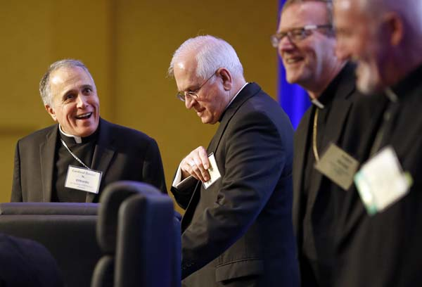 <div class='meta'><div class='origin-logo' data-origin='AP'></div><span class='caption-text' data-credit='AP Photo/Patrick Semansky'>Cardinal Daniel DiNardo, of Galveston-Houston, left, vice president of the United States Conference of Catholic Bishops, and Archbishop Joseph Kurtz, of Louisville, Kentucky</span></div>