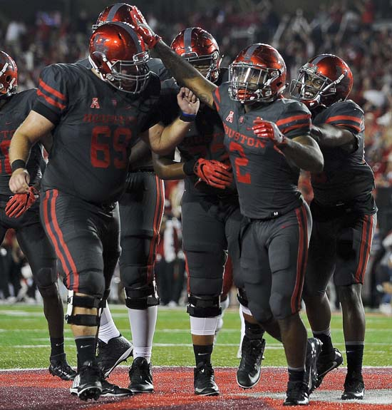 "<div class=""meta image-caption""><div class=""origin-logo origin-image ap""><span>AP</span></div><span class=""caption-text"">Houston running back Duke Catalon (2) celebrates his 13-yard touchdown reception during the first half of an NCAA college football game against Louisville. (AP Photo/Eric Christian Smith)</span></div>"