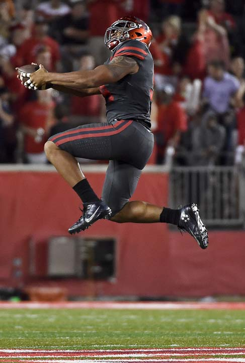 "<div class=""meta image-caption""><div class=""origin-logo origin-image ap""><span>AP</span></div><span class=""caption-text"">Houston defensive end Cameron Malveaux (94) celebrates his fumble recovery during the first half of an NCAA college football game against Louisville. (AP Photo/Eric Christian Smith)</span></div>"