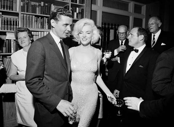 <div class='meta'><div class='origin-logo' data-origin='AP'></div><span class='caption-text' data-credit='Cecil Stoughton/White House Photographs, John F. Kennedy Presidential Library and Museum via AP'>Marilyn Monroe wears the iconic gown that she wore while singing &#34;Happy Birthday&#34; to President John F. Kennedy</span></div>