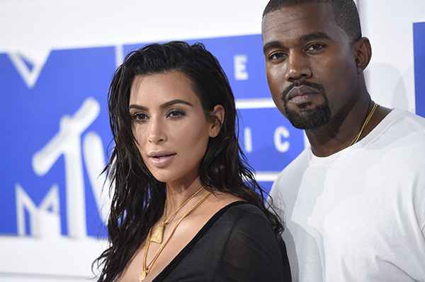 <div class='meta'><div class='origin-logo' data-origin='AP'></div><span class='caption-text' data-credit='Evan Agostini/Invision/AP'>Kim Kardashian West, left, and Kanye West arrive at the MTV Video Music Awards at Madison Square Garden on Sunday, Aug. 28, 2016, in New York. (Photo by Evan Agostini/Invision/AP)</span></div>
