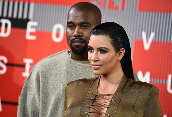 <div class='meta'><div class='origin-logo' data-origin='AP'></div><span class='caption-text' data-credit='Jordan Strauss/Invision/AP'>Kanye West, left, and Kim Kardashian arrive at the MTV Video Music Awards at the Microsoft Theater on Sunday, Aug. 30, 2015, in Los Angeles. (Photo by Jordan Strauss/Invision/AP)</span></div>