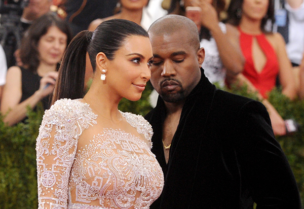 <div class='meta'><div class='origin-logo' data-origin='AP'></div><span class='caption-text' data-credit='AP'>FILE - In this May 4, 2015, file photo, Kim Kardashian, left, and Kanye West arrive at The Metropolitan Museum of Art's Costume Institute benefit gala in New York.</span></div>