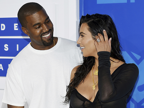 <div class='meta'><div class='origin-logo' data-origin='AP'></div><span class='caption-text' data-credit='AP'>FILE - In this Aug. 28, 2016 file photo, Kanye West, left, and Kim Kardashian West arrive at the MTV Video Music Awards in New York.</span></div>