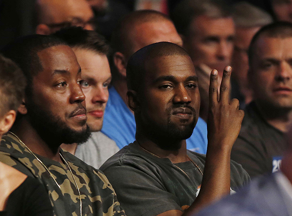 <div class='meta'><div class='origin-logo' data-origin='AP'></div><span class='caption-text' data-credit='AP'>Kanye West gestures while attending UFC 202 on Saturday, Aug. 20, 2016, in Las Vegas. (AP Photo/Isaac Brekken)</span></div>