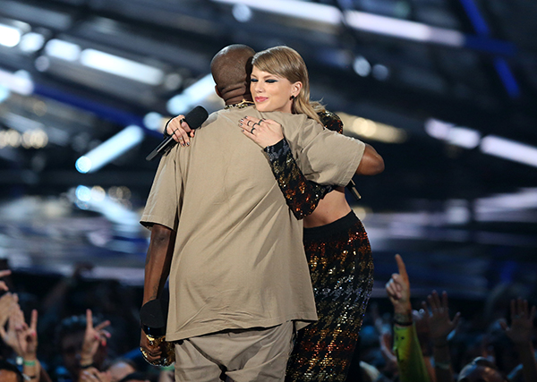 <div class='meta'><div class='origin-logo' data-origin='AP'></div><span class='caption-text' data-credit='Matt Sayles/Invision/AP'>Taylor Swift, right, embraces Kanye West after presenting him with the video vanguard award  at the MTV Video Music Awards.</span></div>