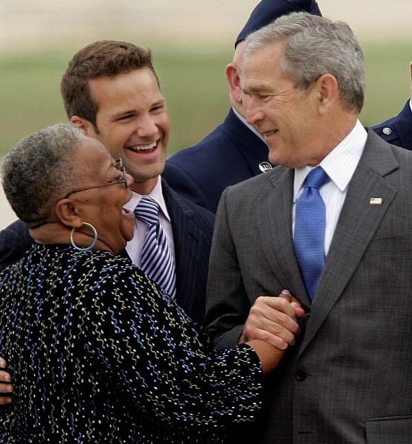 <div class='meta'><div class='origin-logo' data-origin='AP'></div><span class='caption-text' data-credit='AP Photo/Seth Perlman'>President Bush, right, greets Aaron Schockand Aurthur Perkins, former principal of Harrison Primary School</span></div>