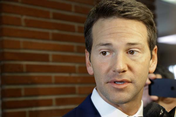 <div class='meta'><div class='origin-logo' data-origin='AP'></div><span class='caption-text' data-credit='AP Photo/Seth Perlman'>Aaron Schock speaks to reporters before meetings with constituents after a week in which he faced twin scandals Friday, Feb. 6, 2015, in Peoria, Illinois.</span></div>