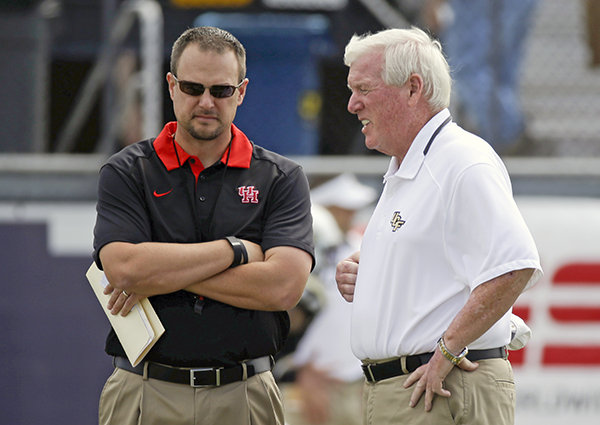 <div class='meta'><div class='origin-logo' data-origin='AP'></div><span class='caption-text' data-credit='AP'>Houston head coach Tom Herman, left, and Central Florida head coach George O'Leary greet each other on the field before an NCAA college football game.</span></div>