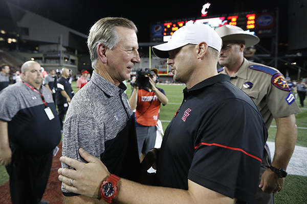 <div class='meta'><div class='origin-logo' data-origin='AP'></div><span class='caption-text' data-credit='AP'>Cincinnati coach Tommy Tuberville, left, meets with Houston coach Tom Herman after an NCAA college football game, Thursday, Sept. 15, 2016.</span></div>