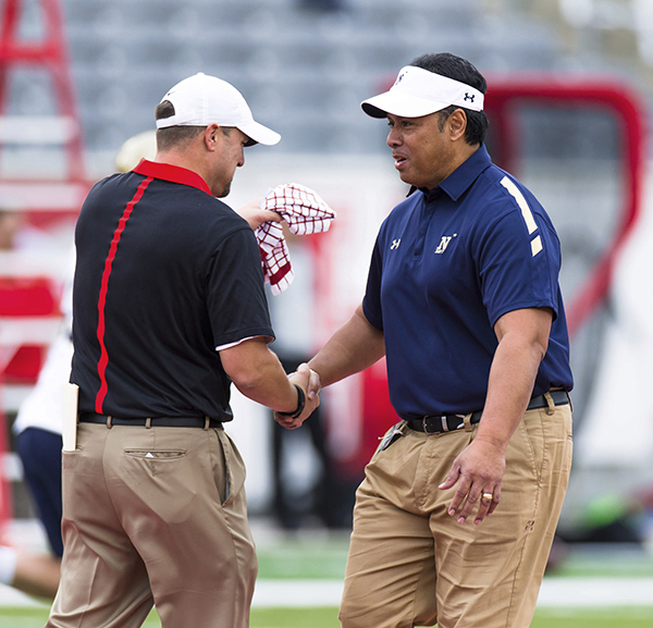 <div class='meta'><div class='origin-logo' data-origin='AP'></div><span class='caption-text' data-credit='AP'>Houston's head coach Tom Herman, left, and Navy's head coach Ken Niumatalolo shake hands on the field before an NCAA college football game between Houston and Navy, in Houston.</span></div>