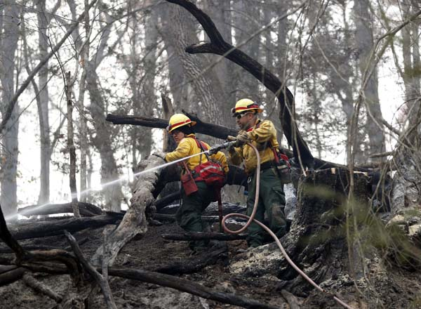 <div class='meta'><div class='origin-logo' data-origin='AP'></div><span class='caption-text' data-credit='AP Photo/John Bazemore'>Firefighters Valarie Lopez, left, and Mark Tabaez work to cool hot spots after a wildfire burned a hillside Tuesday, Nov. 15, 2016, in Clayton, Ga.</span></div>
