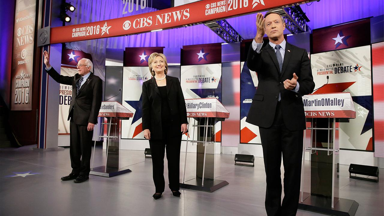 Democratic presidential candidates, from left, Bernie Sanders, Hillary Clinton and Martin OMalley take the stage before a Democratic presidential primary debate in Des Moines, IA.