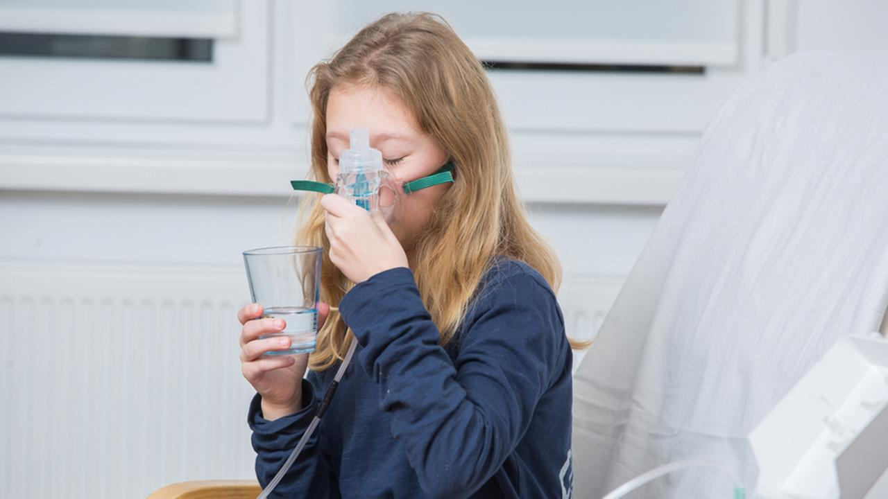 Girl with asthma stock image