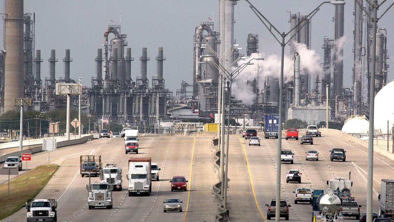 In this Nov. 21, 2007 file photo, Shell Oil Companys Deer Park refinery and petrochemical facility is shown in the background as vehicles travel along Highway 225 in Deer Park, TX