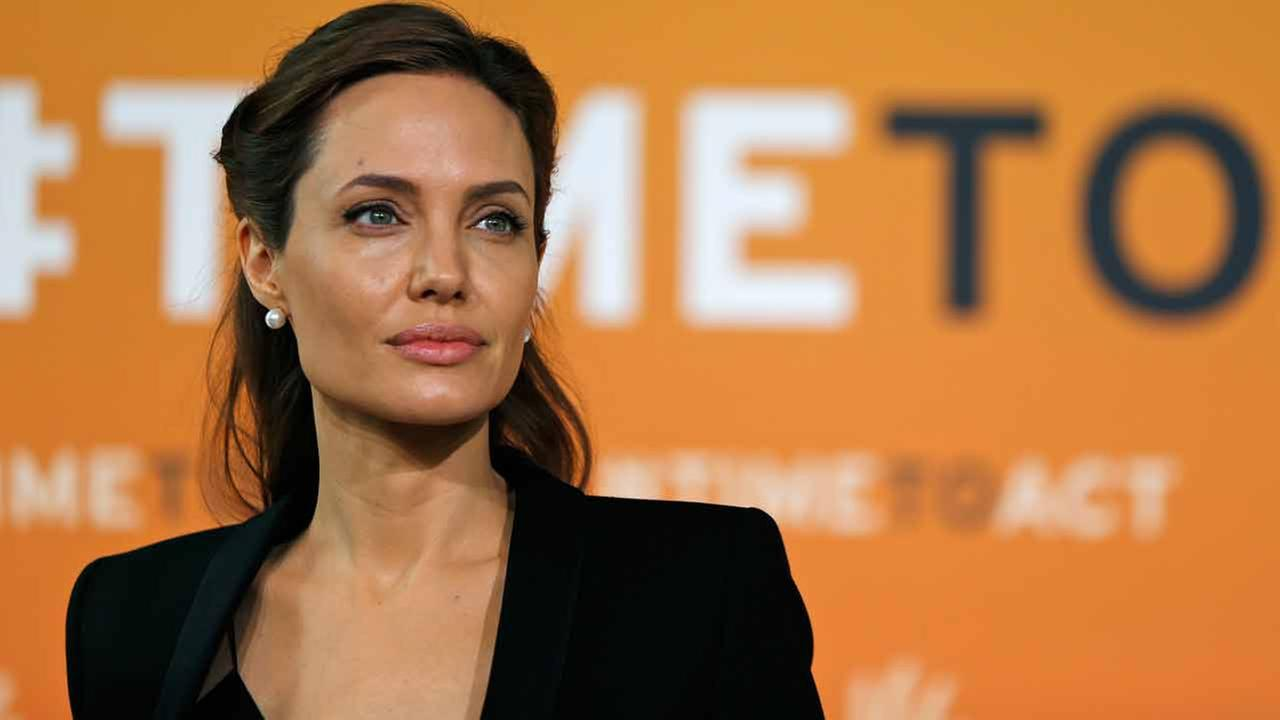 Angelina Jolie, special envoy of the United Nations High Commissioner for Refugees, poses for photographers as she arrives at the End Sexual Violence in Conflict summit.