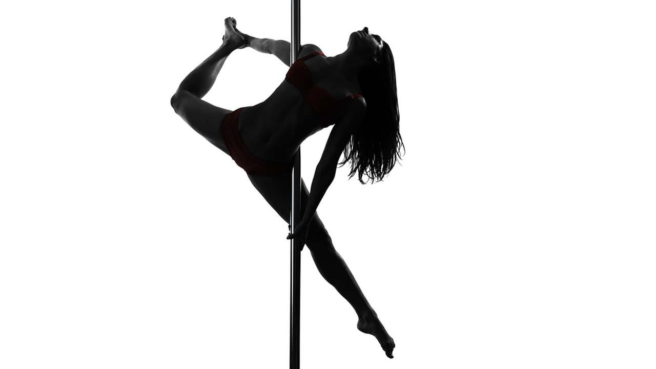 A stock image of a woman pole dancing