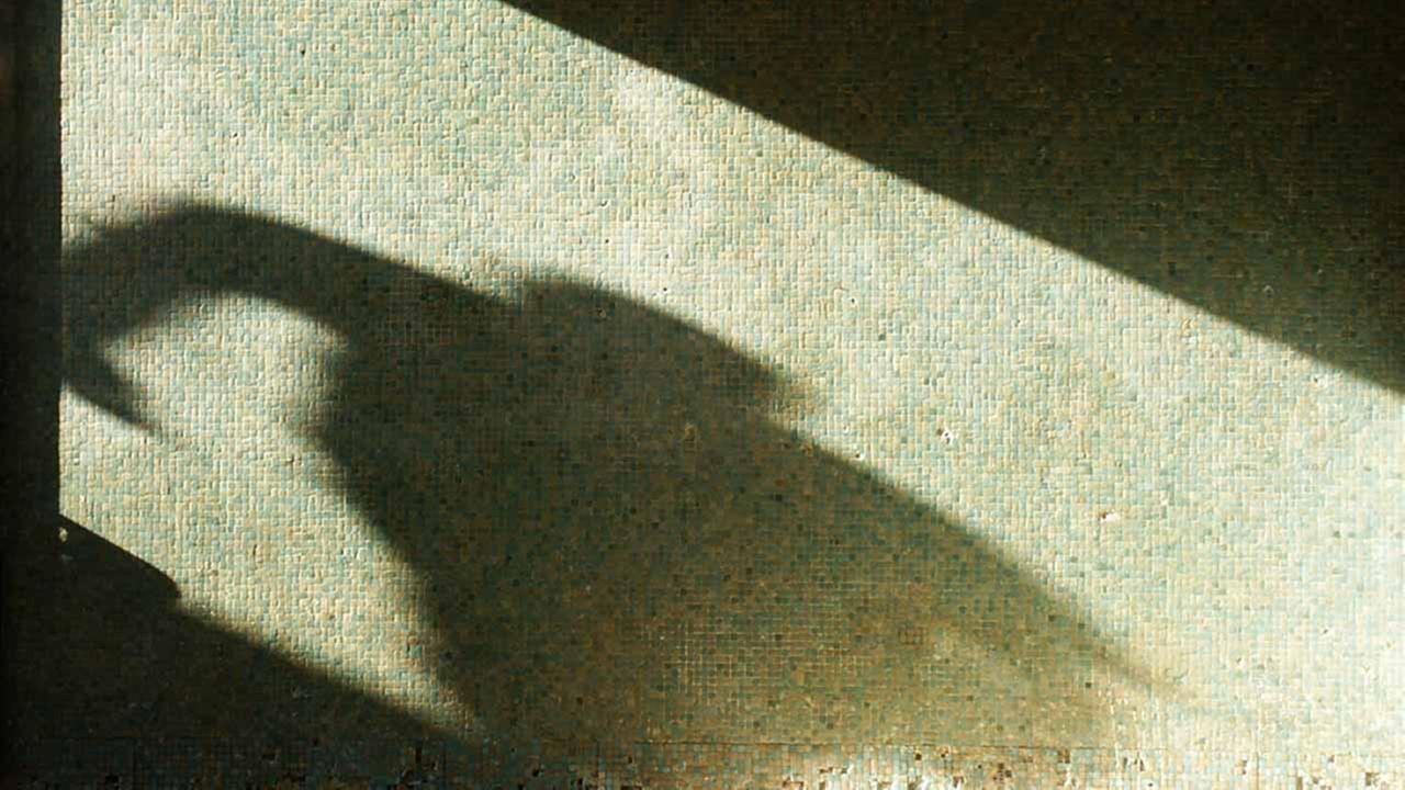 Shadow of man in dark background