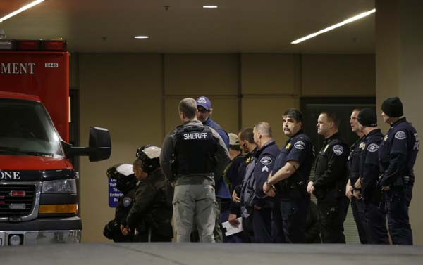 <div class='meta'><div class='origin-logo' data-origin='AP'></div><span class='caption-text' data-credit='AP Photo/Ted S. Warren'>Law enforcement officers stand watch at Tacoma General Hospital</span></div>