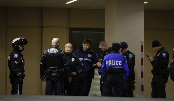 <div class='meta'><div class='origin-logo' data-origin='AP'></div><span class='caption-text' data-credit='AP'>Law enforcement officers gather at Tacoma General Hospital</span></div>
