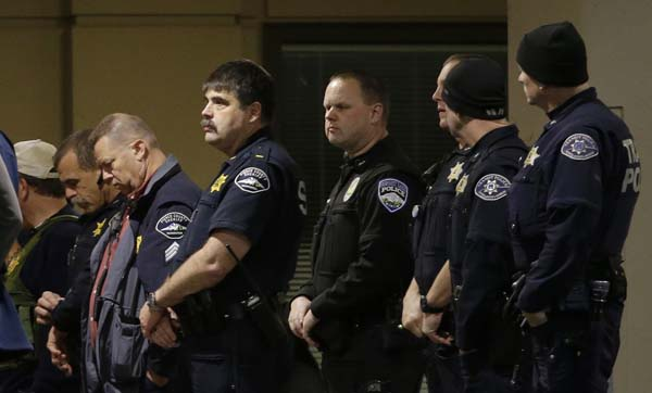 <div class='meta'><div class='origin-logo' data-origin='AP'></div><span class='caption-text' data-credit='AP Photo/Ted S. Warren'>Law enforcement officers gather at Tacoma General Hospital</span></div>
