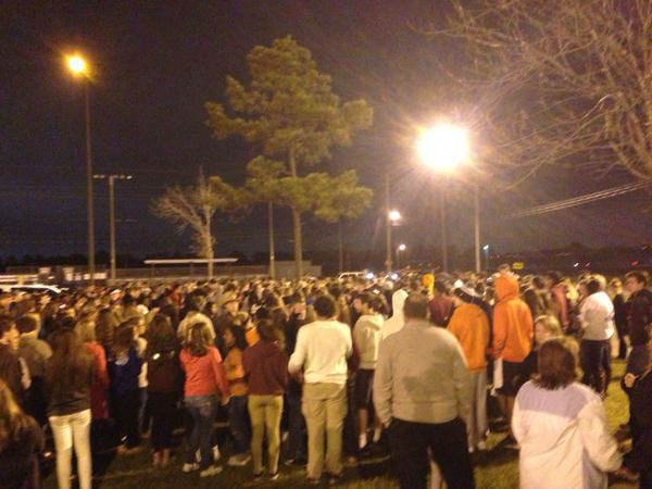 <div class='meta'><div class='origin-logo' data-origin='none'></div><span class='caption-text' data-credit=''>Students gather at Cinco Ranch High School to remember the two students killed Saturday</span></div>