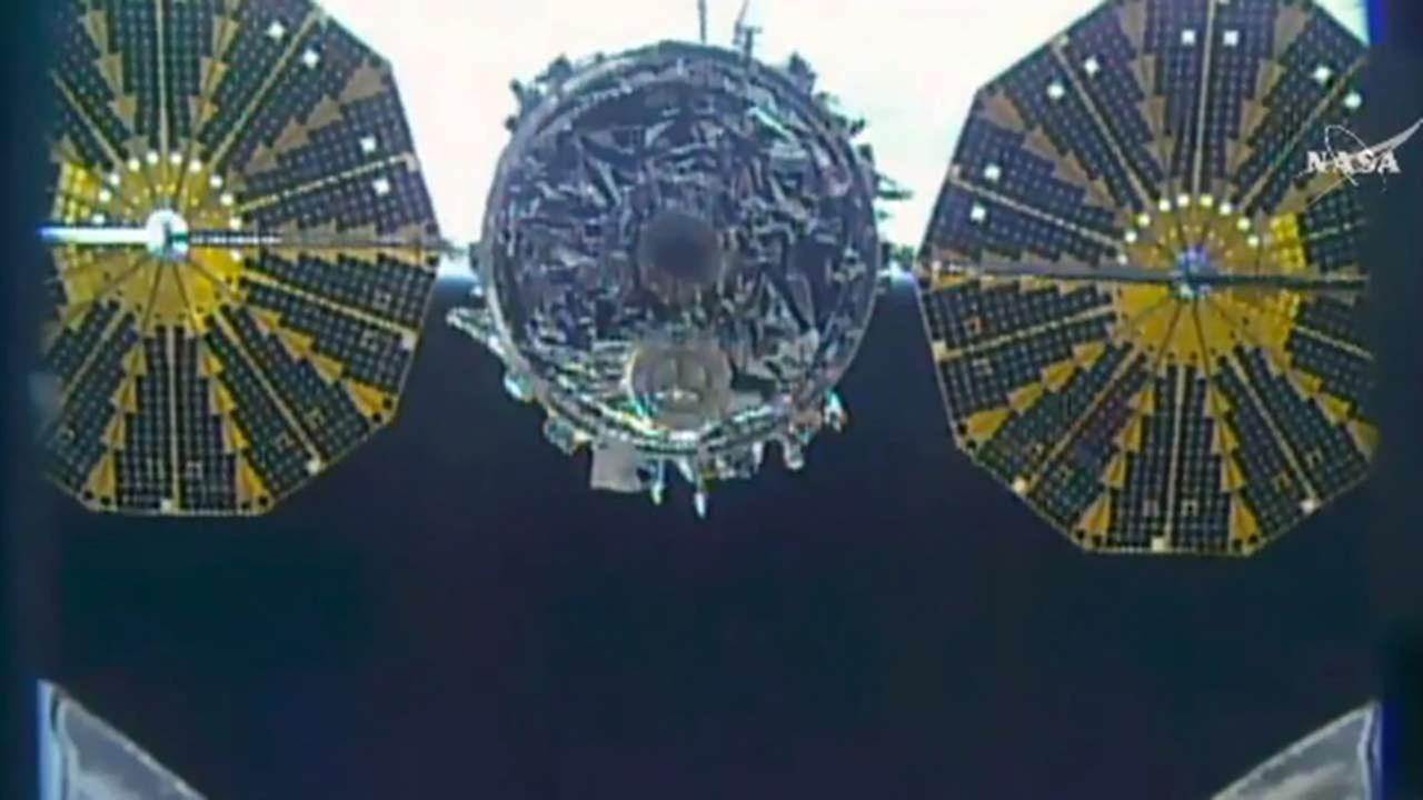 This photo taken from NASA TV shows a close up of a capsule loaded with 1.5 tons of trash released from the International Space Station on Friday, Feb. 19, 2016.