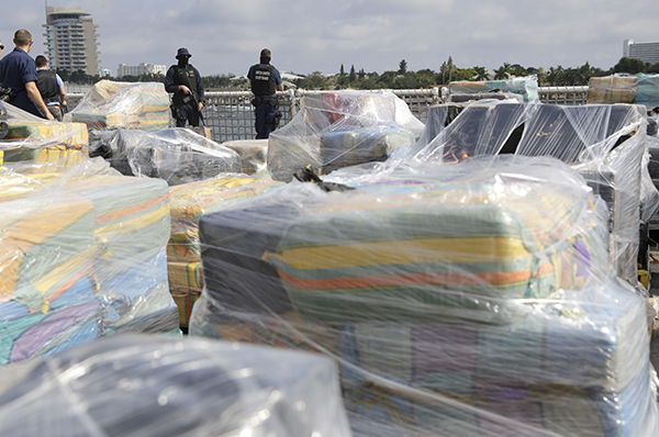 <div class='meta'><div class='origin-logo' data-origin='AP'></div><span class='caption-text' data-credit='AP Photo/Lynne Sladky'>Coast Guardsmen stand over pallets containing more than 26 tons of cocaine worth at least $715 million, on the flight deck of of 418-foot Coast Guard Cutter Hamilton.</span></div>