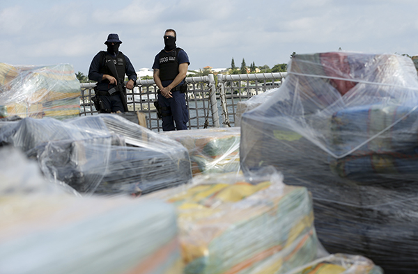 <div class='meta'><div class='origin-logo' data-origin='AP'></div><span class='caption-text' data-credit='AP Photo/Lynne Sladky'>Coast Guardsmen stand over pallets containing more than 26 tons of cocaine worth at least $715 million on the flight deck of of 418-foot Coast Guard Cutter Hamilton.</span></div>