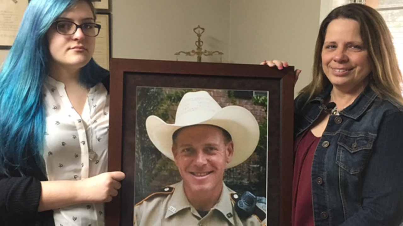 Late deputys family sued