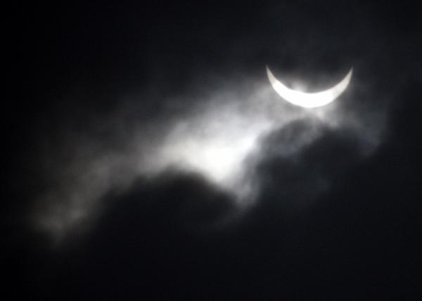 <div class='meta'><div class='origin-logo' data-origin='AP'></div><span class='caption-text' data-credit='AP Photo/Eugene Hoshiko'>A partial solar eclipse is seen among heavy cloud in Yanguan town, Haining City, China, Wednesday, July 22, 2009.</span></div>