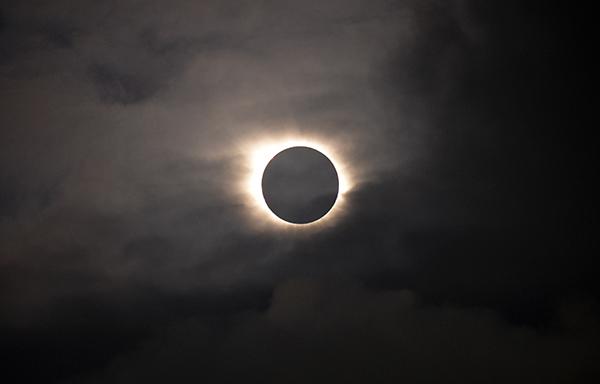 <div class='meta'><div class='origin-logo' data-origin='AP'></div><span class='caption-text' data-credit='AP Photo/Eric Adams'>A total solar eclipse is visible through the clouds as seen from Vagar on the Faeroe Islands, Friday, March 20, 2015.</span></div>