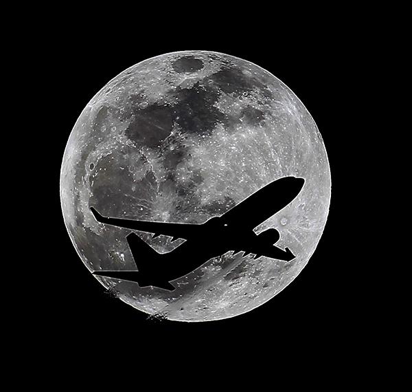 <div class='meta'><div class='origin-logo' data-origin='AP'></div><span class='caption-text' data-credit='AP Photo/Nick Ut'>An airliner crosses the moon's path, Monday, April 14, 2014, above Whittier, Calif., approximately one hour before a total lunar eclipse.</span></div>