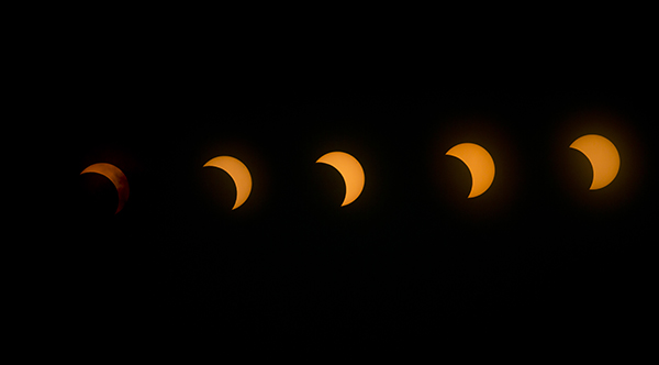 <div class='meta'><div class='origin-logo' data-origin='AP'></div><span class='caption-text' data-credit='AP Photo/Ben Curtis'>This multiple exposure image shows the transition from right to left of a hybrid solar eclipse seen over Lake Oloidien near Naivasha in Kenya Sunday, Nov. 3, 2013.</span></div>