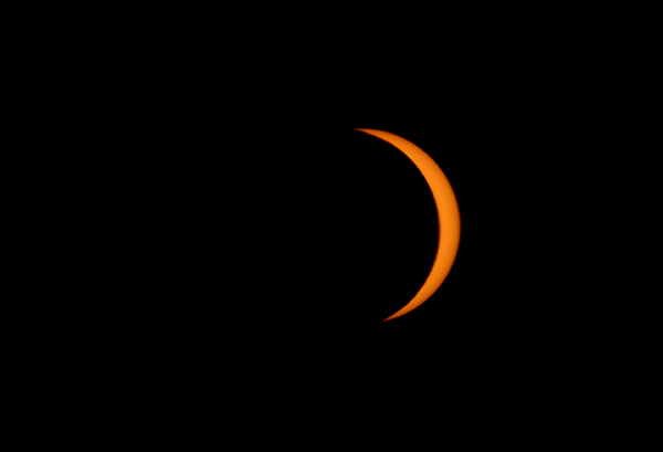 <div class='meta'><div class='origin-logo' data-origin='AP'></div><span class='caption-text' data-credit='AP Photo/Achmad Ibrahim'>A partial solar eclipse is seen in Jakarta, Indonesia, Wednesday, March 9, 2016.</span></div>