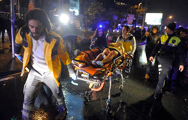 "<div class=""meta image-caption""><div class=""origin-logo origin-image ap""><span>AP</span></div><span class=""caption-text"">Medics carry a wounded person at the scene after an attack at a popular nightclub in Istanbul, early Sunday, Jan. 1, 2017. (IHA via AP)</span></div>"