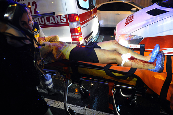 <div class='meta'><div class='origin-logo' data-origin='AP'></div><span class='caption-text' data-credit='IHA via AP'>Medics carry a wounded person at the scene after an attack at a popular nightclub in Istanbul, early Sunday, Jan. 1, 2017.</span></div>