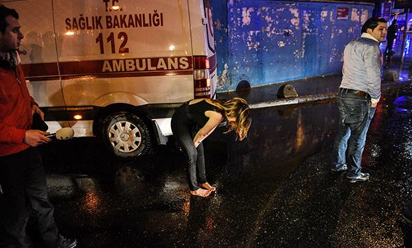 <div class='meta'><div class='origin-logo' data-origin='AP'></div><span class='caption-text' data-credit='AP Photo'>A woman reacts next to an ambulance near the scene of an attack in Istanbul, early Sunday, Jan. 1, 2017.</span></div>