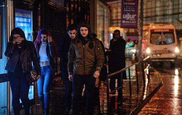 <div class='meta'><div class='origin-logo' data-origin='AP'></div><span class='caption-text' data-credit='AP Photo'>Young people leave from the scene of an attack in Istanbul, early Sunday, Jan. 1, 2017.</span></div>