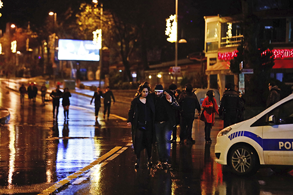 "<div class=""meta image-caption""><div class=""origin-logo origin-image ap""><span>AP</span></div><span class=""caption-text"">Young people leave from the scene of an attack in Istanbul, early Sunday, Jan. 1, 2017. (AP Photo/Halit Onur Sandal)</span></div>"