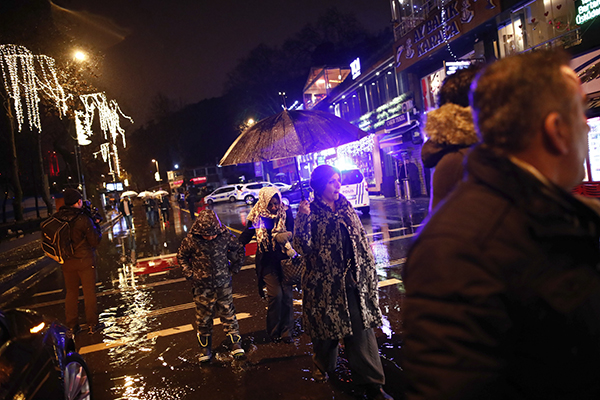 "<div class=""meta image-caption""><div class=""origin-logo origin-image ap""><span>AP</span></div><span class=""caption-text"">People walk under rain near the scene of an attack in Istanbul, early Sunday, Jan. 1, 2017. (IHA via AP)</span></div>"